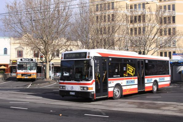 Moonee Valley Coaches 2271AO #71 departs Moonee Ponds Junction with a route 506 service