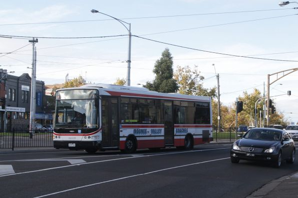 Moonee Valley Coaches bus #75 2275AO on a route 503 service departs Essendon station