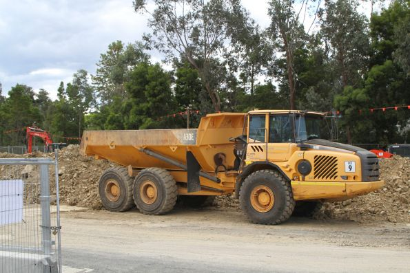 Articulated dump truck ready to clear the north side of the construction site