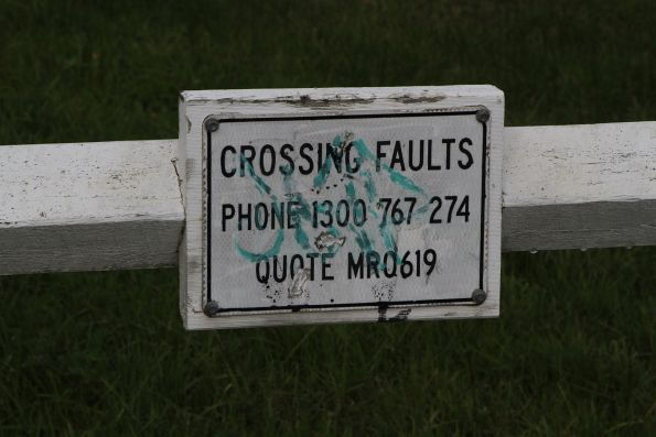 'Crossing faults' sign at the 61.9km pedestrian crossing at Narambi