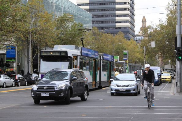 Dimwit attempting to turn right in front of a tram at Elizabeth and La Trobe Streets