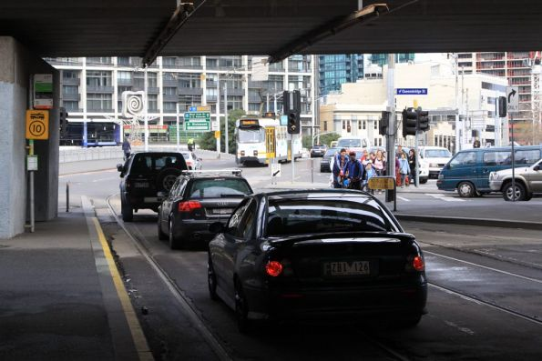 Four cars in all missed the turn into Flinders Street and drove along the tram tracks to Queens Bridge