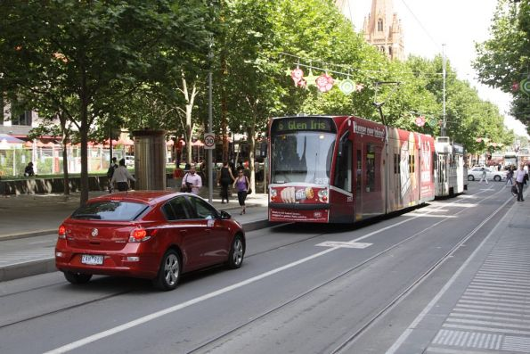 Dingbat tries to follow a tram through the City Sqaure tram stop on Swanston Street