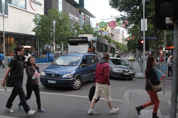 Pair of confused motorists ponder their choices at the corner of Swanston and Little Lonsdale Streets