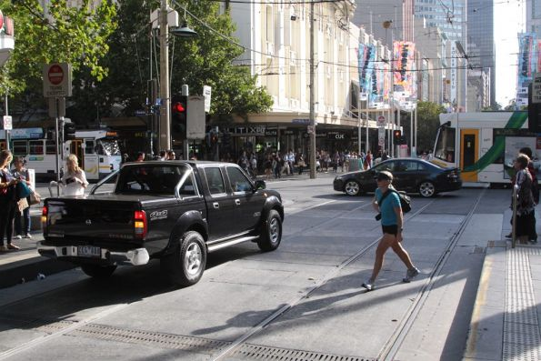 Corner of Bourke and Swanston in the Melbourne CBD: why are cars heading down both streets!?