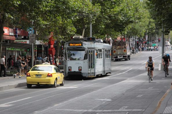 Taxi attempts to follow tram Z3.139 through the tram stop on Swanston Street