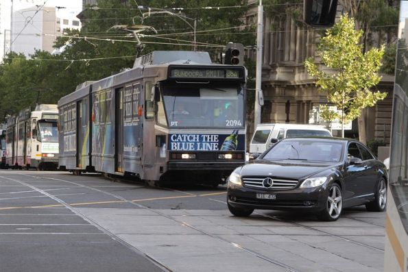 Douchebag in a Mercedes tries to turn right in front of two trams, at the corner of Spencer and Bourke Streets