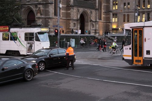 Yarra Trams staff ask another motorist to clear the tram tracks: Victoria Police nowhere to be seen