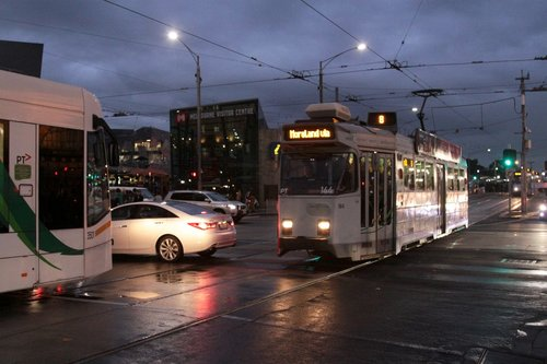 Z3.144 and D1.3501 wait for a car blocking the tracks at Swanston and Flinders Streets