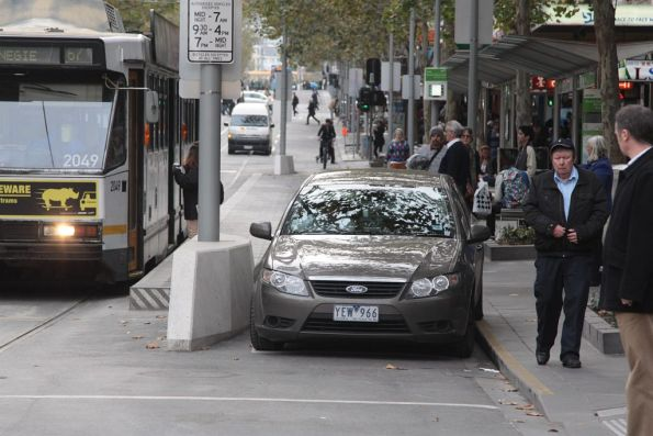Car drives through the bike only part of the Swanston Street tram stop