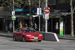 Confused motorist headed north along Swanston Street at Collins