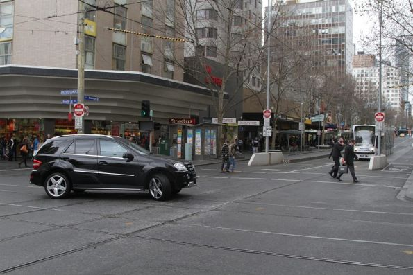 Driver of a Mercedes 4WD finally realises you can't drive up Swanston Street