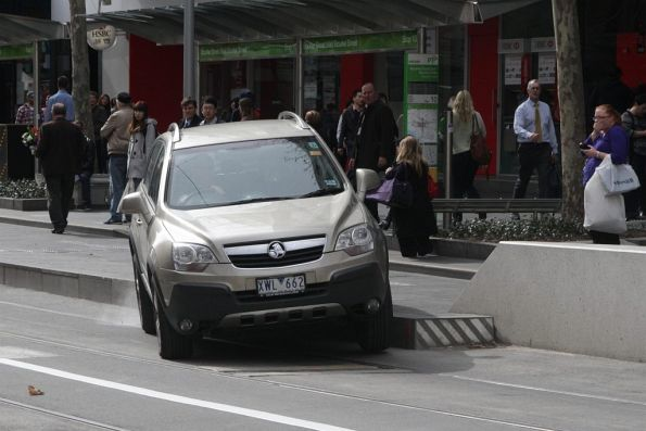 Motorist realises they can't get any further down the Swanston Street bike lane at the Bourke Street stop