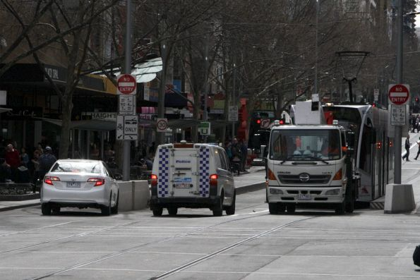 Confused motorist northbound on Swanston Street, getting a talking to by the police