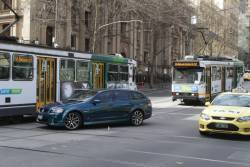 Car on Collins Street blocks two trams in their attempt to turn into Swanston Street