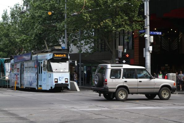 Northbound trams at Swanston and La Trobe Streets delayed by a wanker in a Land Rover