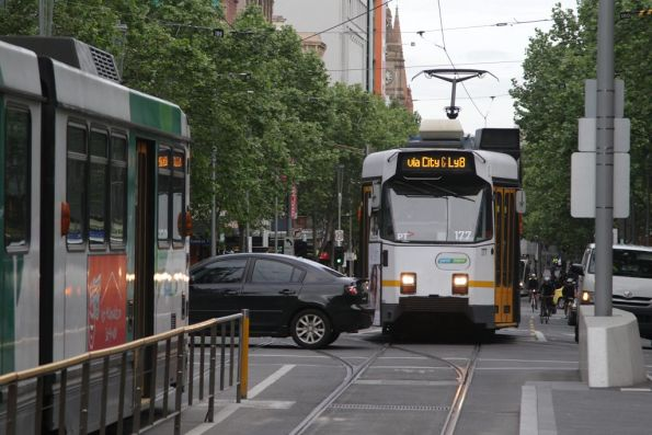 Trams on Swanston Street delayed by a car queuing through the Little Lonsdale Street intersection