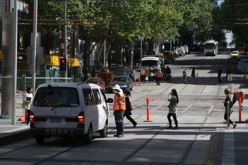 Traffic controller at the corner of Bourke and Elizabeth Street tells the campervan driver they need to go back the way they came
