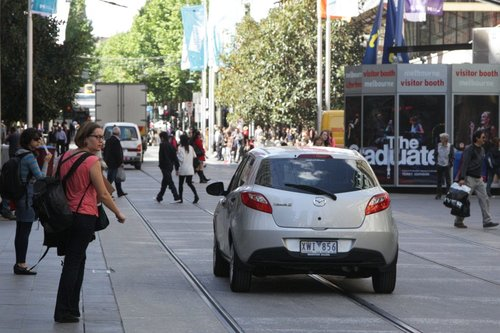 Crisis averted? Three vehicles head back out of the Bourke Street Mall