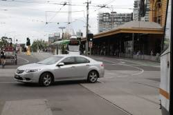 Another car blocks trams in both directions at Swanston and Flinders Streets