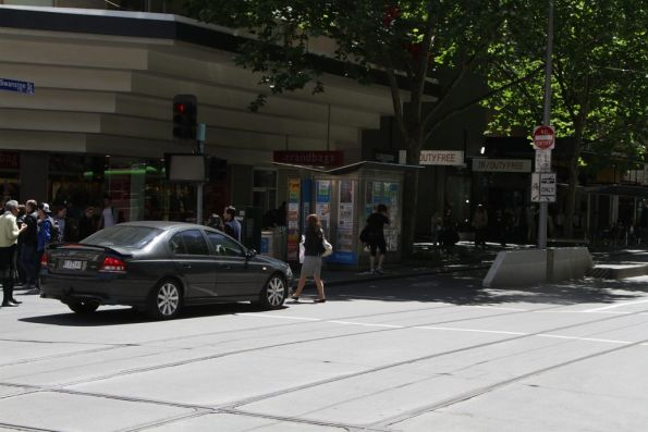 Confused motorists has second thoughts at the corner of Bourke and Swanston Streets