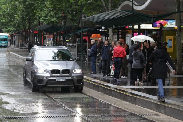 Confused pedestrians watched Nuffy BMW driver cruise through the Bourke and Swanston Street tram stop