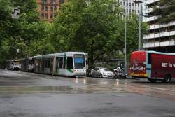 Westbound trams on Collins Street delayed after a bus completed a hook turn into William Street