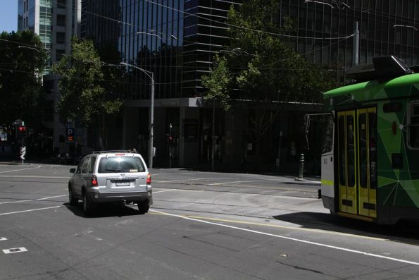 Motorist missed the stop line at the corner of William Street and Flinders Lane, blocking a turning route 55 tram