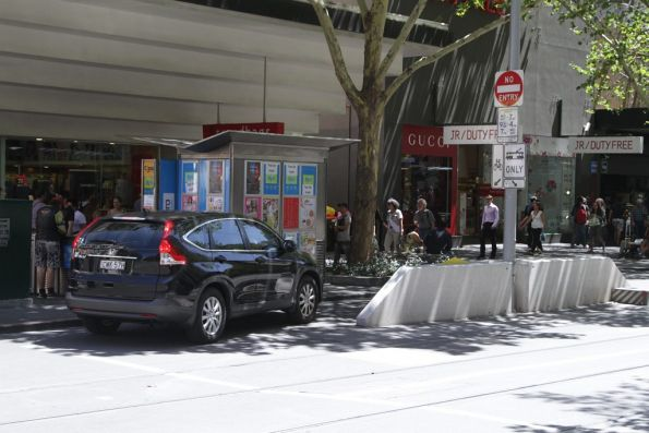 Motorist from NSW drives through the bike lane at the Swanston and Bourke tram stop