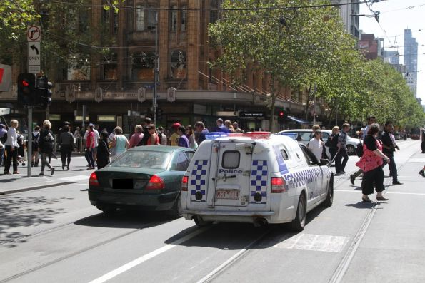 Sign of the apocalypse - Victoria Police pull over a car that drove through a Swanston Street tram stop