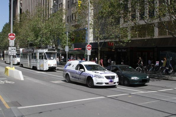 Victoria Police pull over a car that drove through the Swanston and Collins Street tram stop