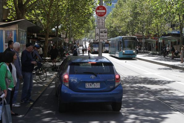 Having drive south down the bike lane, now the blue car tries to head back the other way!