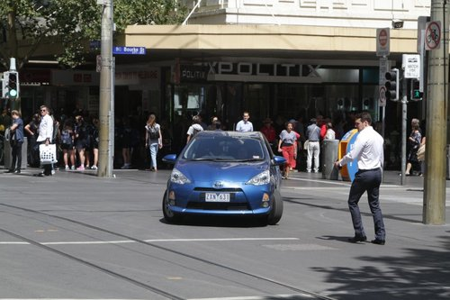 Driver of the blue car reversed out of the bike lane, at Bourke and Swanston Street