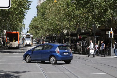 Having driven down the bike lane twice, they finally head the right way at Bourke and Swanston Street