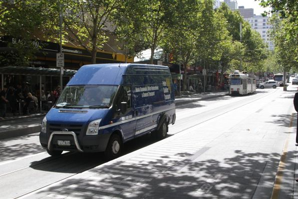 Van driver heads south through the Swanston and Bourke Street tram stop