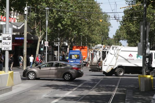 Swanston and Bourke Street isn't a road: so why are two different vehicles turning these?