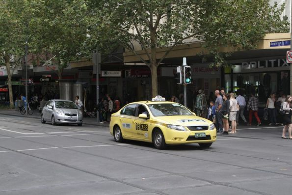 Taxi driver decides the road rules don't apply to him at the corner of Swanston and Bourke Street