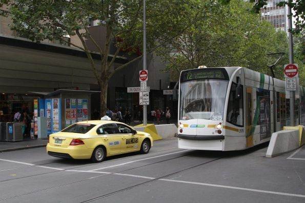 Tram driver goes DING DING DING as the taxi driver guns it down the Swanston Street tram tracks