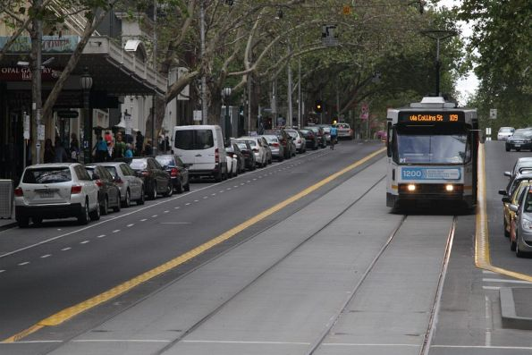 A2.293 heads west along Collins Street at Swanston Street