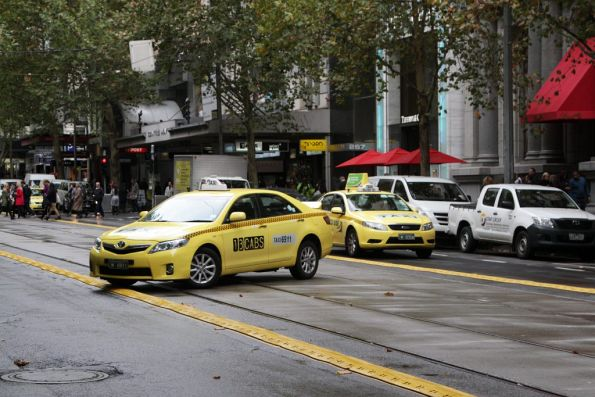 Plastic kerbs along the Collins Street tram stops don't do much to deter taxi drivers from making u-turns