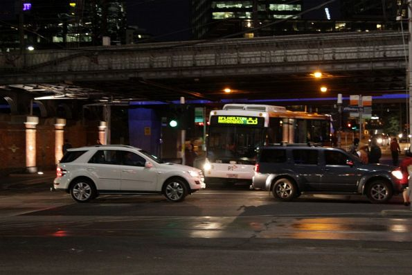 Queued cars on Flinders Street prevent a route 253 bus from turning out of Queensbridge Street
