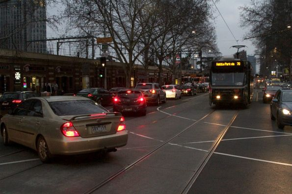 Right turning cars from Queen Street delay trams on Flinders Street