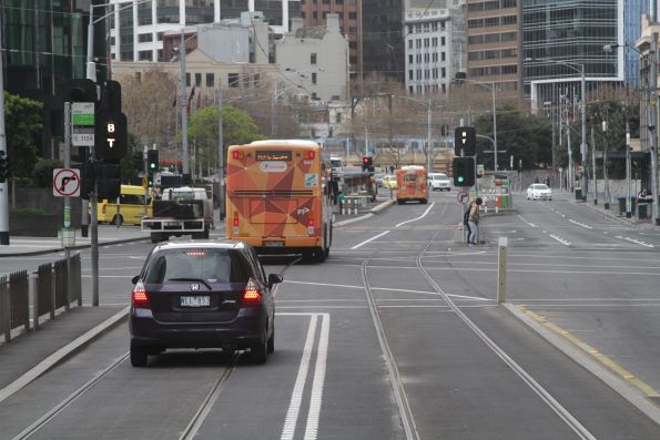 Confused motorists drives along the combined bus and tram lane on Queensbridge Street