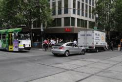 Douchebag in a Mercedes gets caught in the middle at Collins and Swanston Street