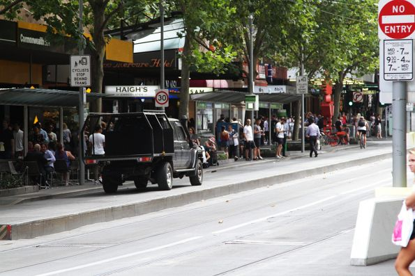 Ute driver drives north up the Swanston Street bike lane