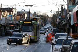 Blocked by a right turning car on Glenferrie Road, Z3.229 heads south on route 16 near Glenferrie station