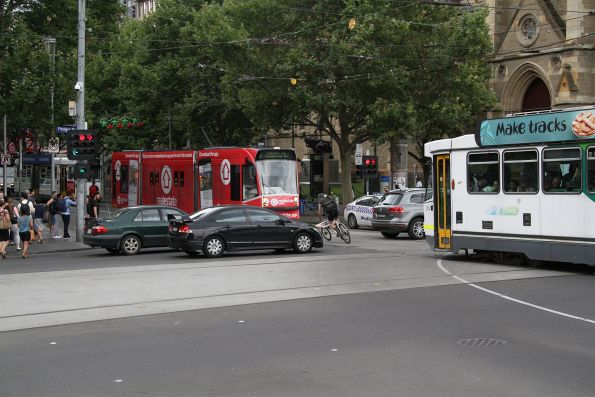 Trams at Flinders and Swanston Street blocked by cars queuing through the intersection