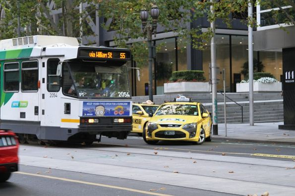 Route 55 tram travelling south on William Street slams on the brakes before an ignorant taxi driver u-turns across the front