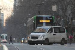 E.6042 delayed on Collins Street due to a courier van doing a u-turn