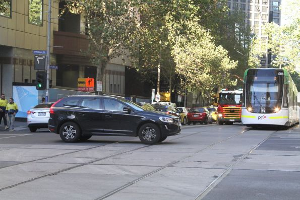 Volvo driver manages to block both a tram and a fire truck at the corner of William and Collins Street